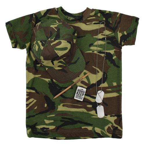 Image shows a camouflage t-shirt of  dark green, brown, black and yellowy-green, on top of this is a baseball cap in the same colours, there is also a Bodmin Keep: Cornwall's Army Museum logo pencil and eraser and a set of metal dog tags on top of the t-shirt.