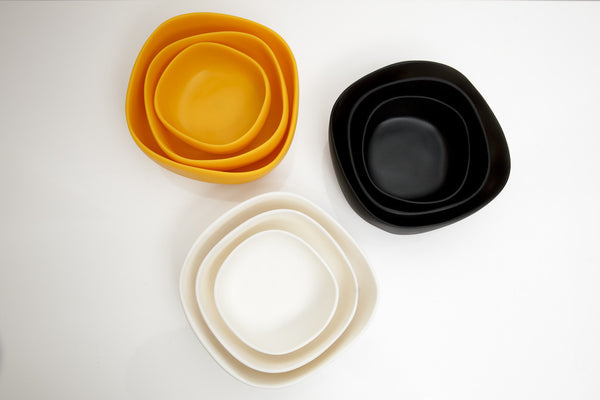 Yellow, Black, and White resin bowls