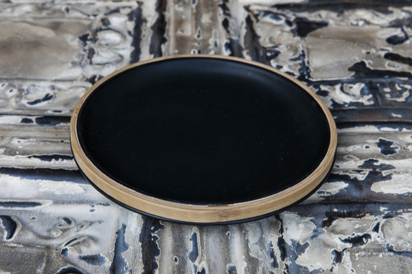black porcelain and bamboo plate