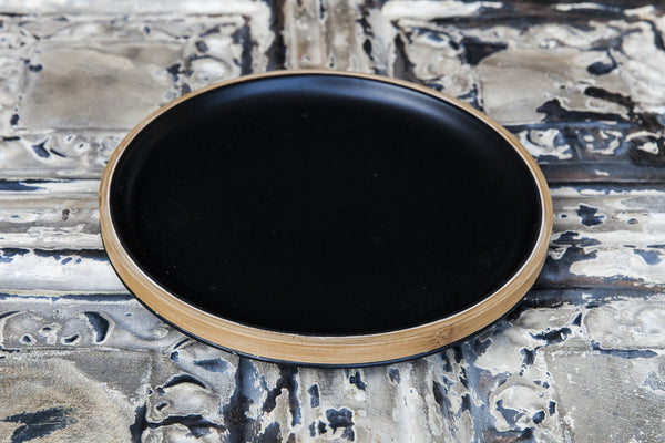 black porcelain and bamboo dinner plate