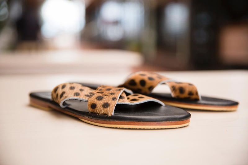KelK. Animal Print Cowshide Slides