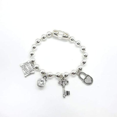 Silber Armband mit diversen Anhänger - Love traveling Armband KOOMPLIMENTS