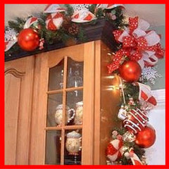 Christmas garlands over kitchen cabinets