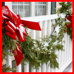 Christmas garland on porch railing