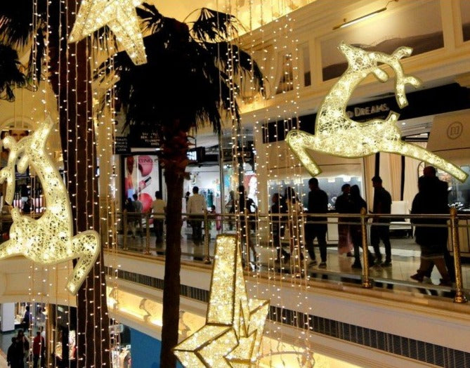 Shopping Mall Holiday Decor with Illuminated Reindeer, Stars and Curtain Lighting