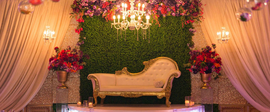Green Hedge Wall with Florals at Meridian Banquet Hall by M Wedding & Events
