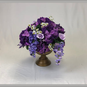 Purple floral centrepiece for wedding reception