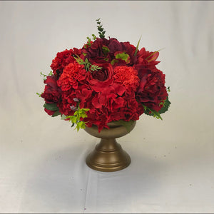 Red floral centrepiece for wedding reception