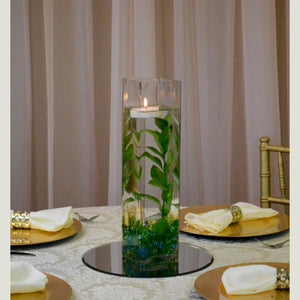 Cylinder with green leafs centrepiece