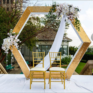 Hexagon backdrop with flowers and drape