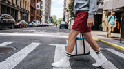 Man crossing the street wearing comfy Nice Laundry lounge shorts.