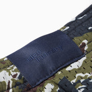 Navy blue tonal jacquard label on the back.