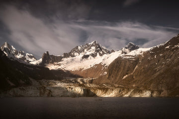 The sun rises on John Hopkins Glacier in Glacier Bay National Park.