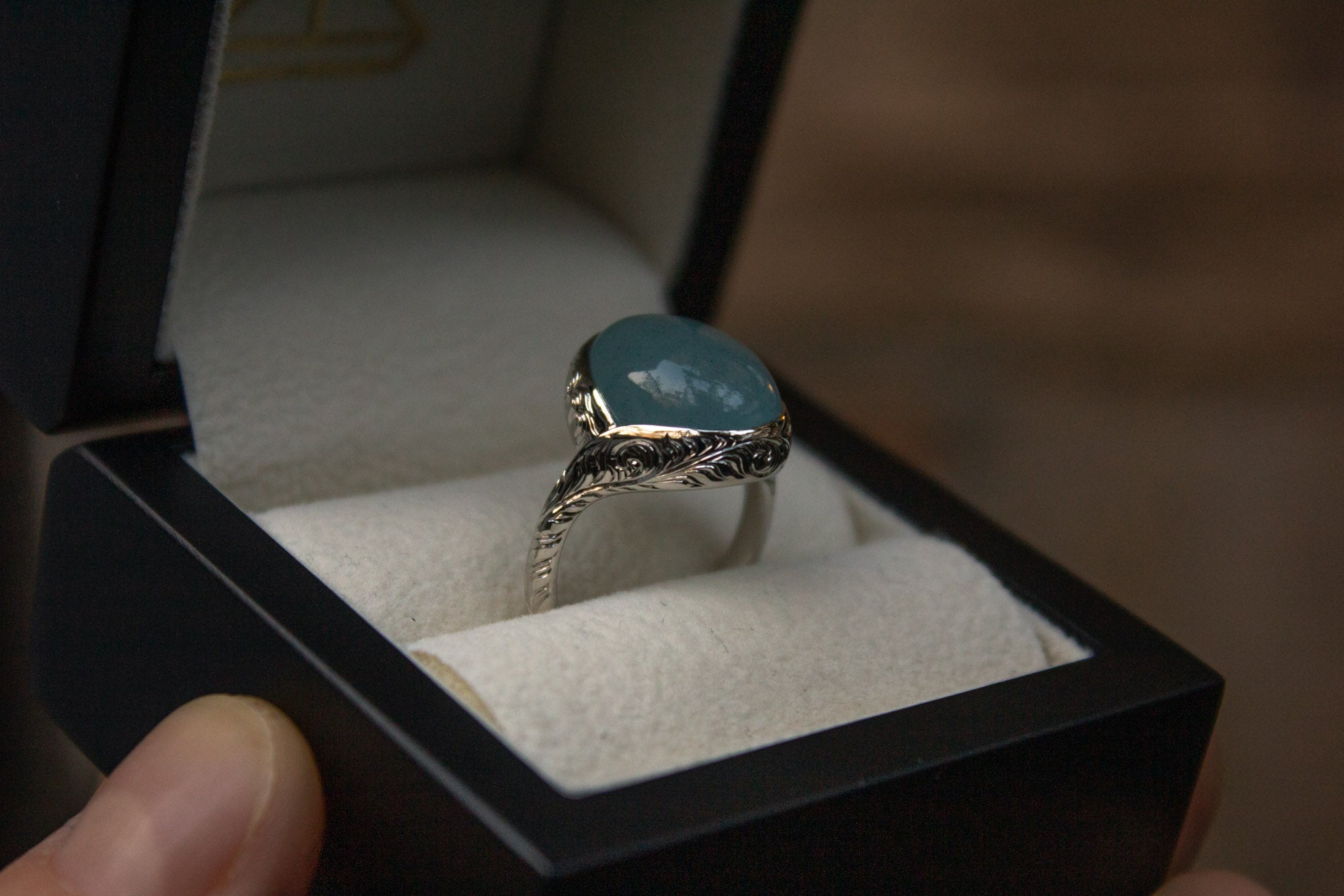 Bespoke cabochon aquamarine engraved platinum ring