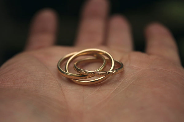 Intertwining Gold Rings