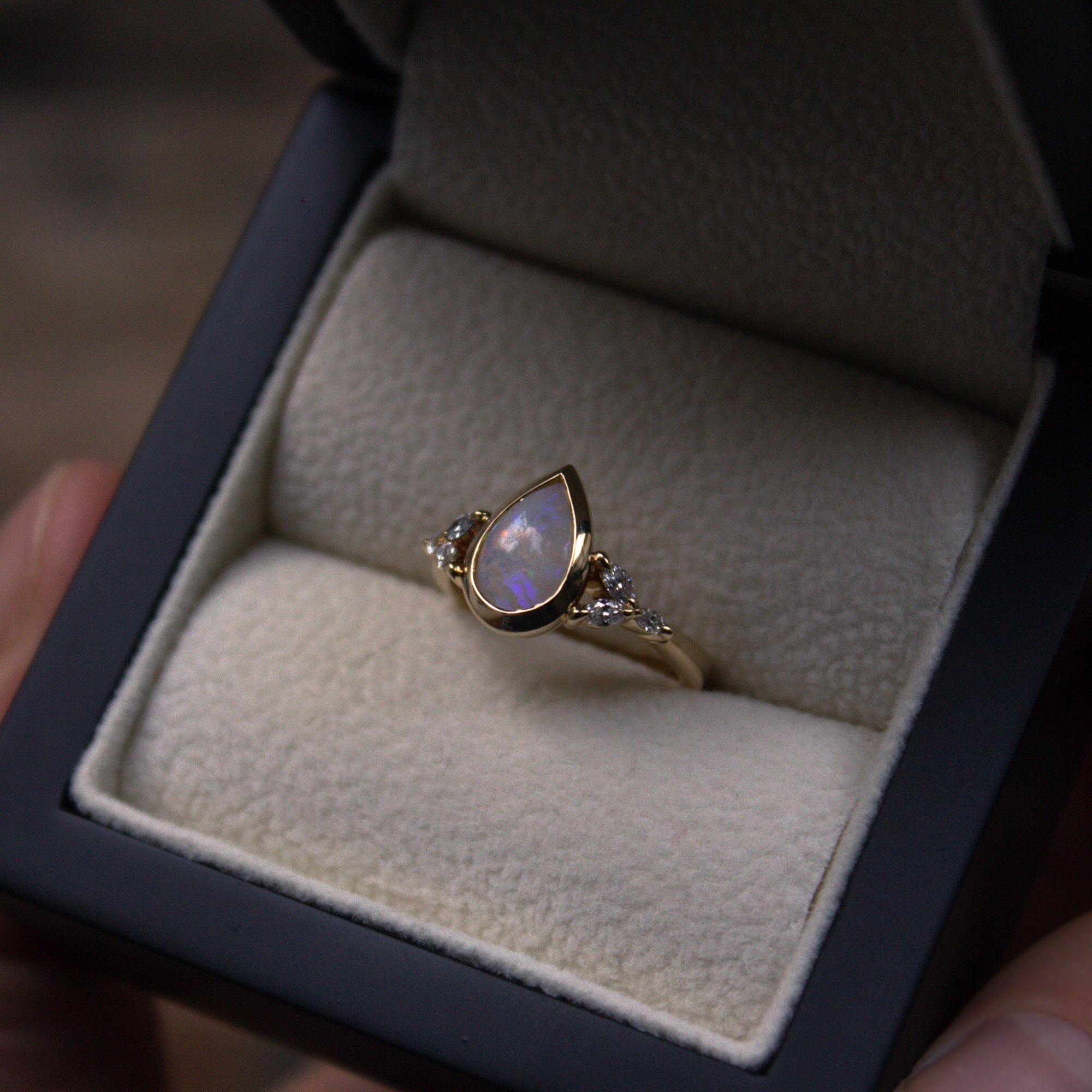 Bespoke oval and diamond engagement ring
