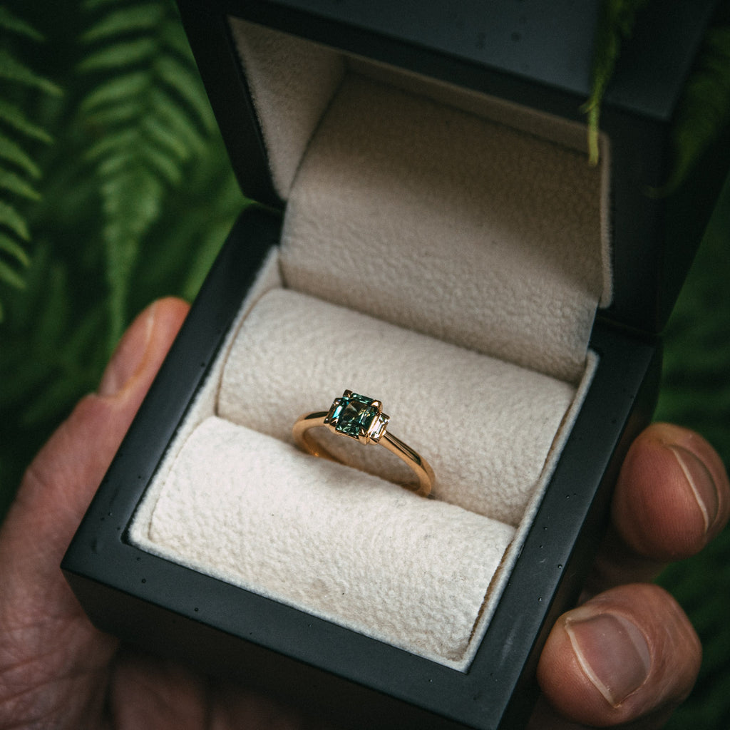 Bespoke Emerald Cut Teal Sapphire and Diamond Engagement Ring