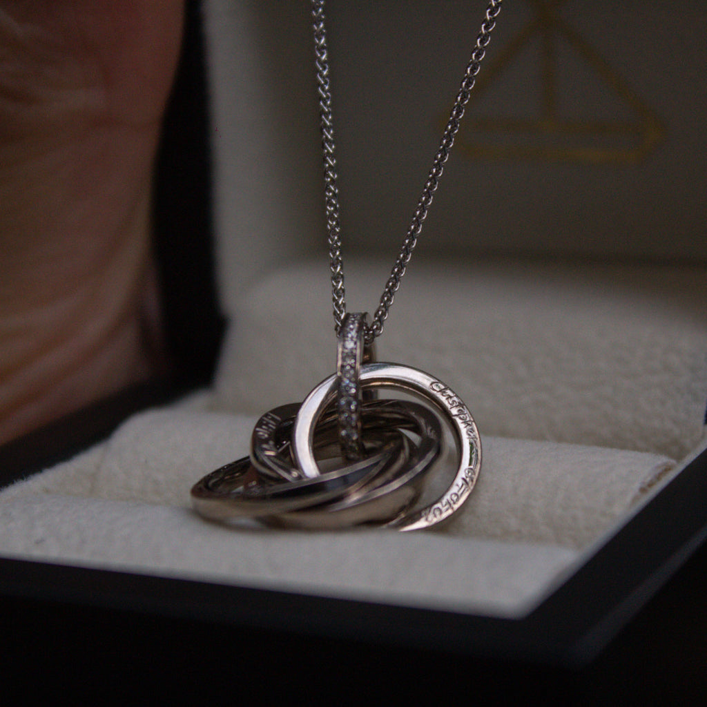 Bespoke white gold engraved pendant