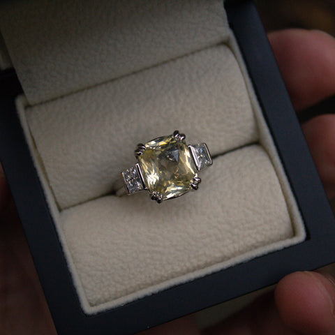 Bespoke yellow sapphire and diamond ring