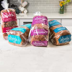 All four varieties of gluten-free bread from Éban's Bakehouse in packaging on kitchen counter