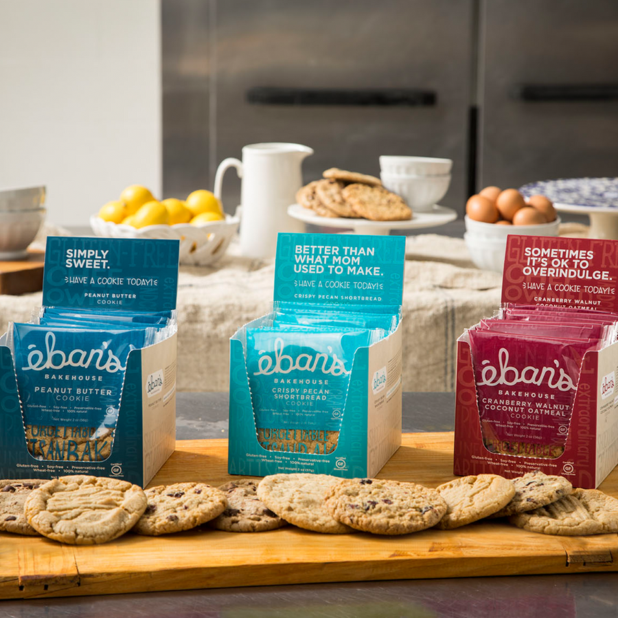All five varieties of individually packed gluten-free cookies from Éban's Bakehouse in open point of purchase packaging
