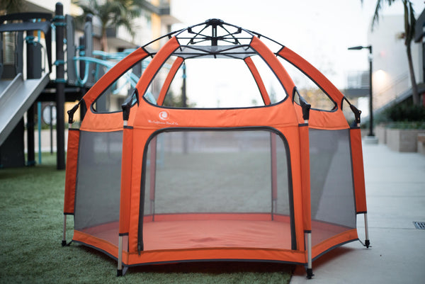 The Pop N Go Playpen outside