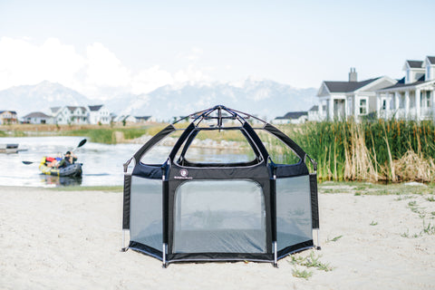 A Pop N Go Playpen positioned on the lake for a family to play