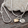 Sterling Silver Beaded Necklace with with Two Heart Charms - dannynewfeld