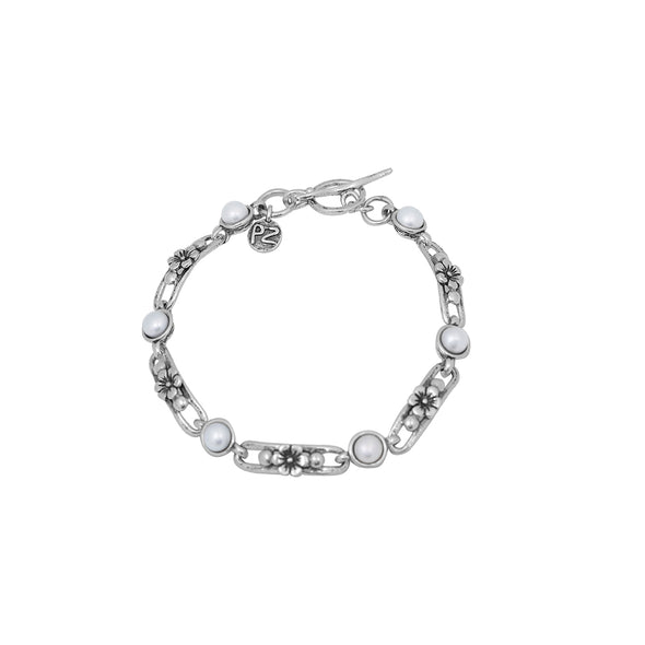 Luxurious Sterling Silver Pearl Link Bracelet with a Floral Design - dannynewfeld