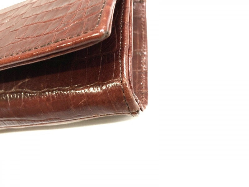 Bordeaux embossed leather clutch bag [pre-owned]
