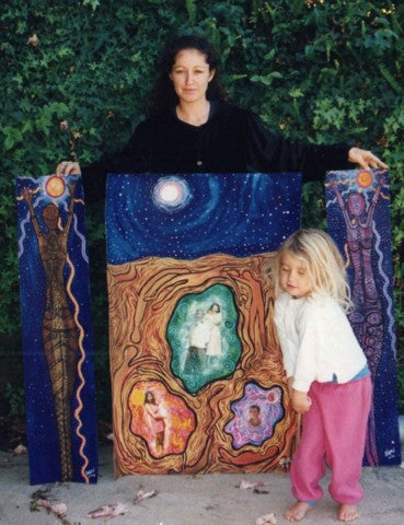 Jingalu Craig, with her daughter and one or her artworks