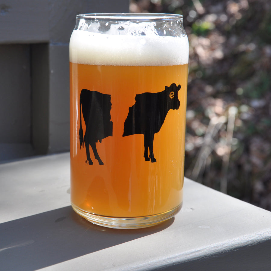 Belty the Cow Vermont beer glass on white. Artist designed belted cow VT pint glass.