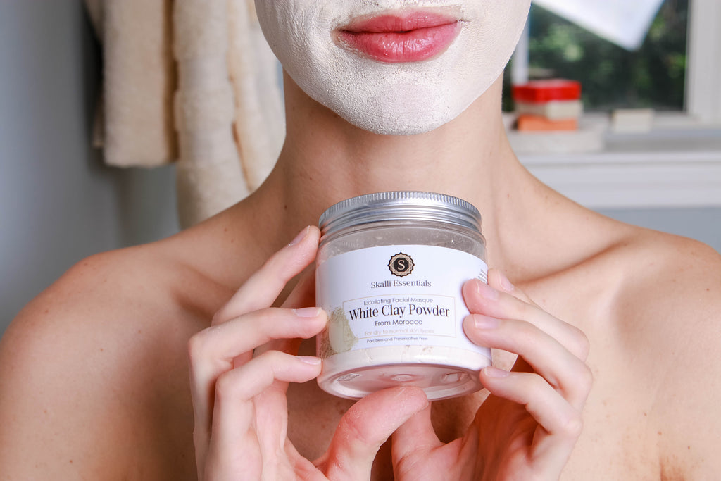 Moroccan White Clay Kaolin Powder Mask on Smiling Woman's Face by Skalli Essentials