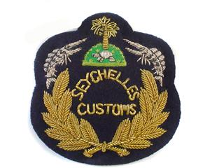 SEYCHELLES CUSTOMS CAP BADGE IN WREATH (4334431109192)