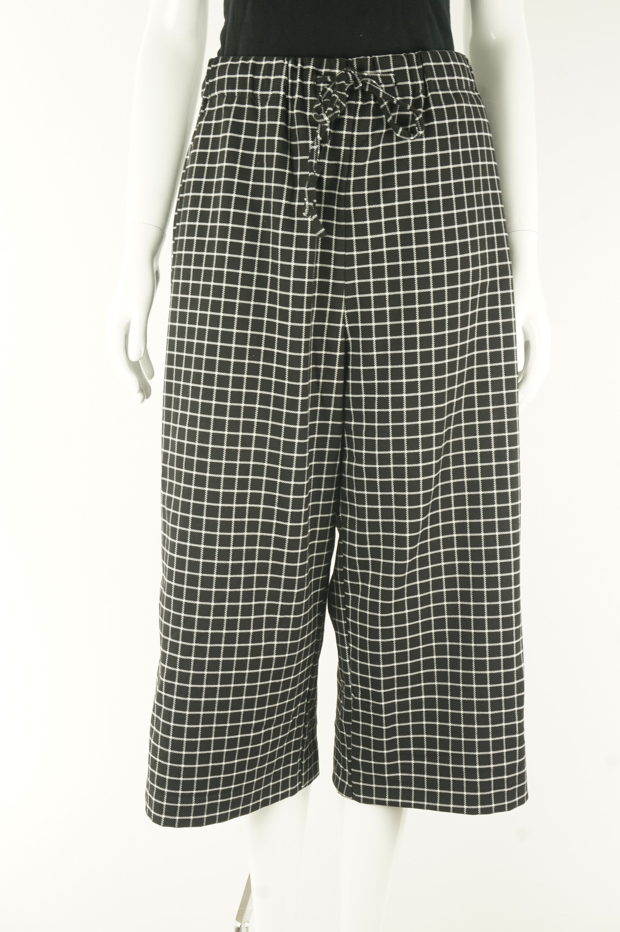 Monki Checked Wide Leg Pants With Elastic Waistband, High waisted wide legged pants are my new favorite! Why? For the exact moment after dinner when you feel overly stuffed but the pants are expandable and hides the food baby…, Black, White, 67% Polyester, 32% Viscose, 1% Elastane, women's Pants, women's Black, White Pants, Monki women's Pants, Women's wide legged checker  capri pants, women's loose fitting checker capri trousers