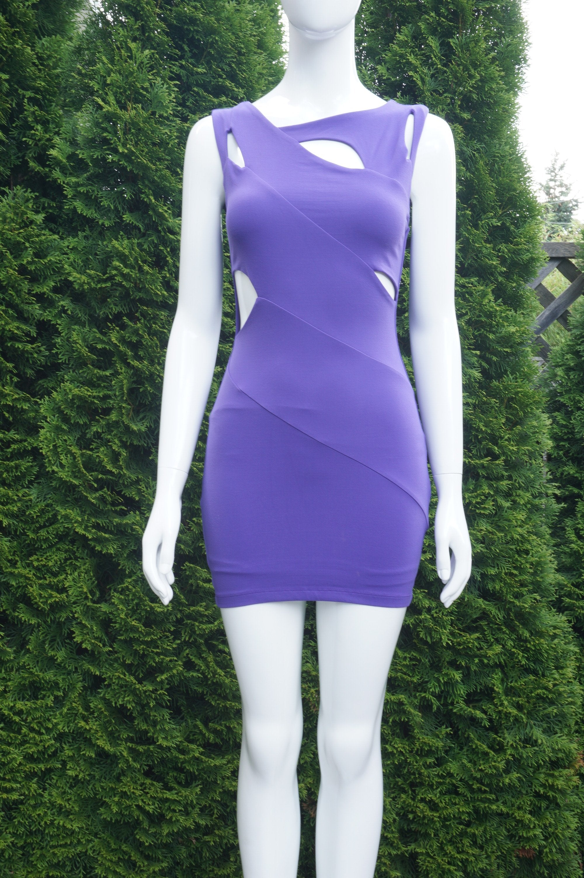 Bebe Purple Sleeveless Mini Dress with Cut-out Design, Stretchy material. Bust 30 inches, Waist 23 inches, length 30 inches, Purple, Body: 88% Nylon, 12% Spandex. Lining: 95% Polyester, 5% Spandex, women's Dresses & Rompers, women's Purple Dresses & Rompers, Bebe women's Dresses & Rompers, cut-out dress, bodycon dress,