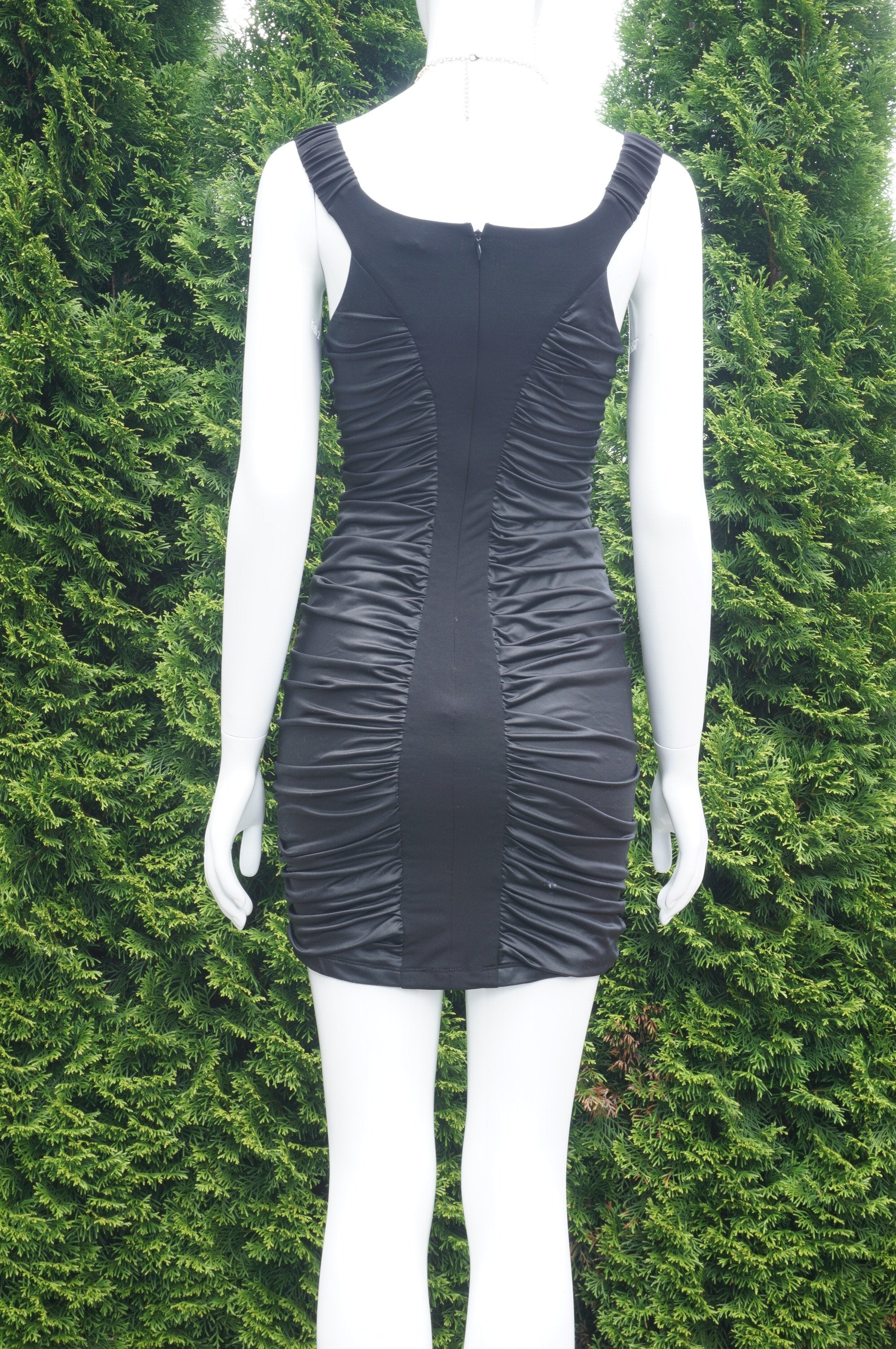 Bebe Sleeveless Stretchy Black Mini Dress, Very Stretchy Dress. Bust 30 inches, waist 26 inches, length 30 inches., Black, 94% Polyester, 6% Spandex. Lining: 100% Polyester, women's Dresses & Rompers, women's Black Dresses & Rompers, Bebe women's Dresses & Rompers, mini dress, bodycon dress, black mini dress
