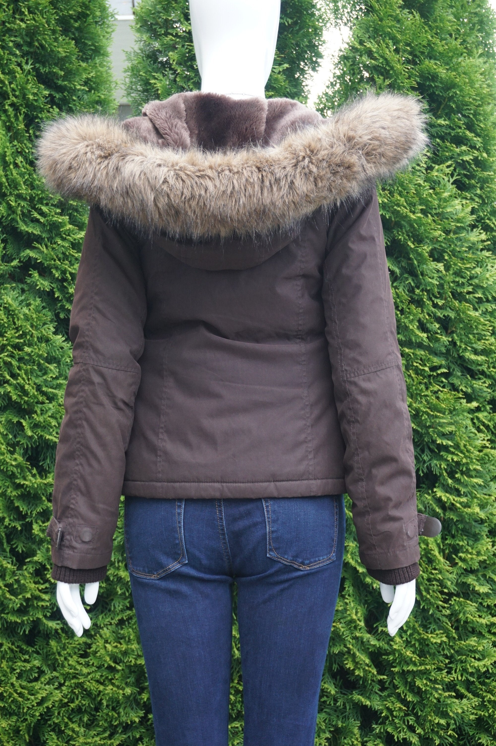 TNA Super warm hooded winter jacket, Bust 36 inches, waist 30 inches, length   inches. Signs of wearing at trims but all zippers and buttons work well. Removable faux fur hood. , Brown, Exterior: 88% Polyester, 12% Nylon. Backing: 100% Polyurethane. Upper lining: 100% Polyester, Lower Body and sleeve lining|: 100% Nylon. Filling 100% Polyester. , women's Jackets & Coats, women's Brown Jackets & Coats, TNA women's Jackets & Coats, Warm winter jacket, TNA jacket, hooded jacket,