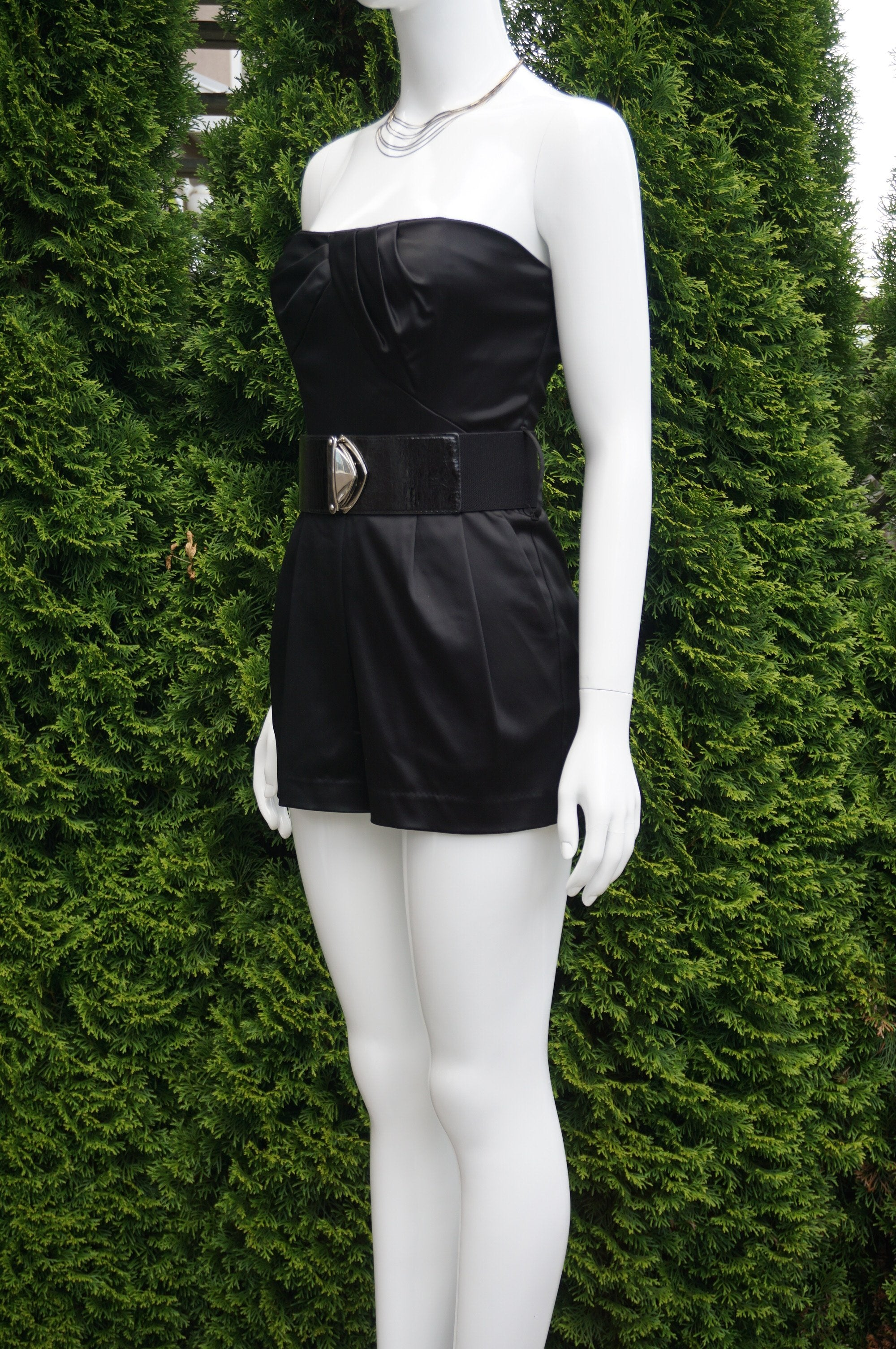Bebe Strapless Heart Solid Black Mini Romper, This Super Stylish and Sexy Mini Romper helps you stand out in the crowd in concerts and night clubs. Complimentaty belt. Breast 31 inches, waist 25 inches, 22 inches length measured from top of breast., Black, Shell: 48% Acetate, 45% Polyamide, 7% Spandex. Lining: 95% polyester, 5% spandex, women's Dresses & Rompers, women's Black Dresses & Rompers, Bebe women's Dresses & Rompers, Solid Black Jumpsuit, Solid Black Mini Romper, Tube Strapless mini romper