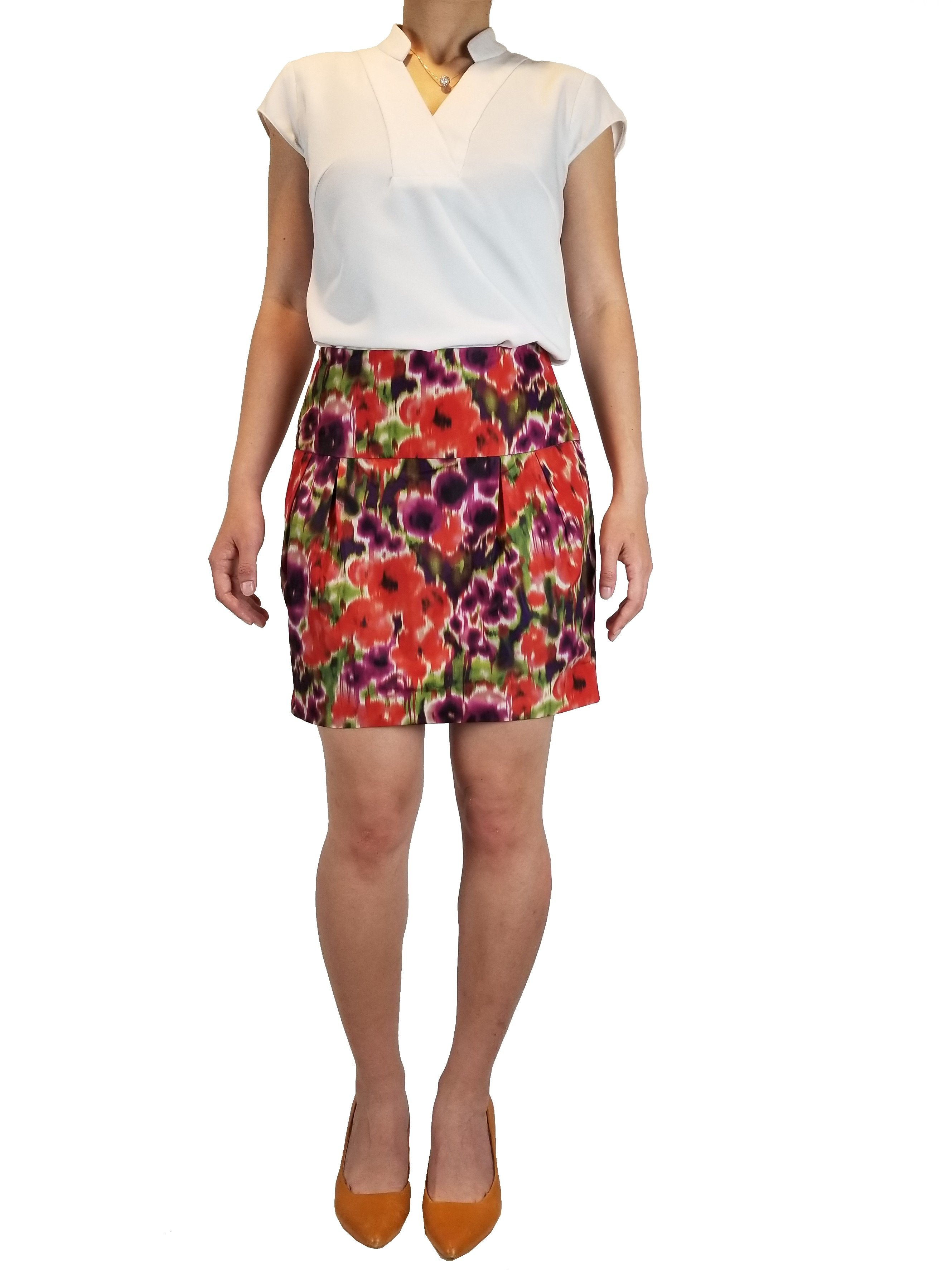 Bebe tie-die orange mini skirt, Vibrant color for the vibrant you!, Orange, Shell: 100% Polyester. Lining: 97% Polyester, 3% Spandex, women's Skirts & Shorts, women's Orange Skirts & Shorts, Bebe women's Skirts & Shorts, skirt, floral purple and orange mini skirt, fashion, floral multi-colored mini skirt