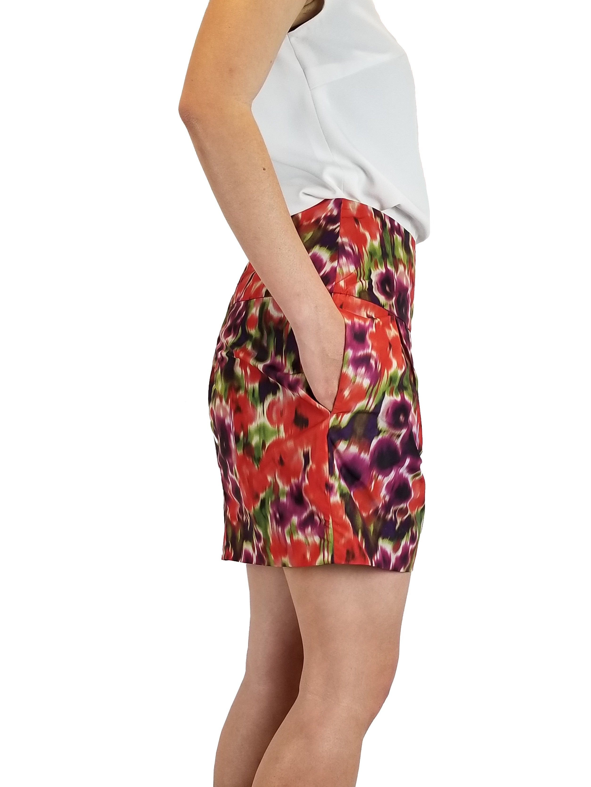 Bebe tie-die orange mini skirt, Vibrant color for the vibrant you!, Orange, Shell: 100% Polyester. Lining: 97% Polyester, 3% Spandex, skirt, floral purple and orange mini skirt, fashion, floral multi-colored mini skirt