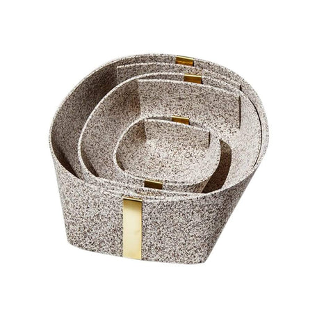 Rubber and Brass Baskets in Sand