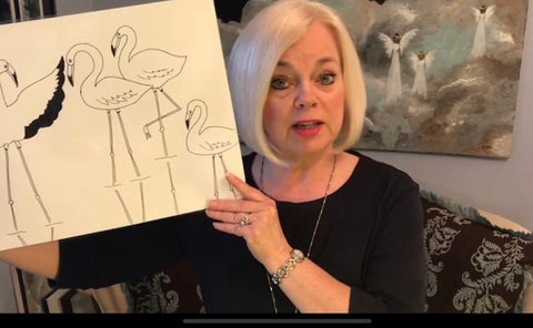 Jo Anne Young Art Teacher Holding up demonstration of drawing flamingos