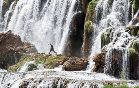 Teen walking on waterfall Idaho Snake River
