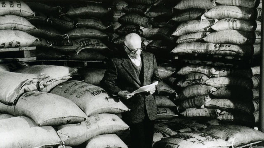 Francisco Gaviña inspecting coffee bags