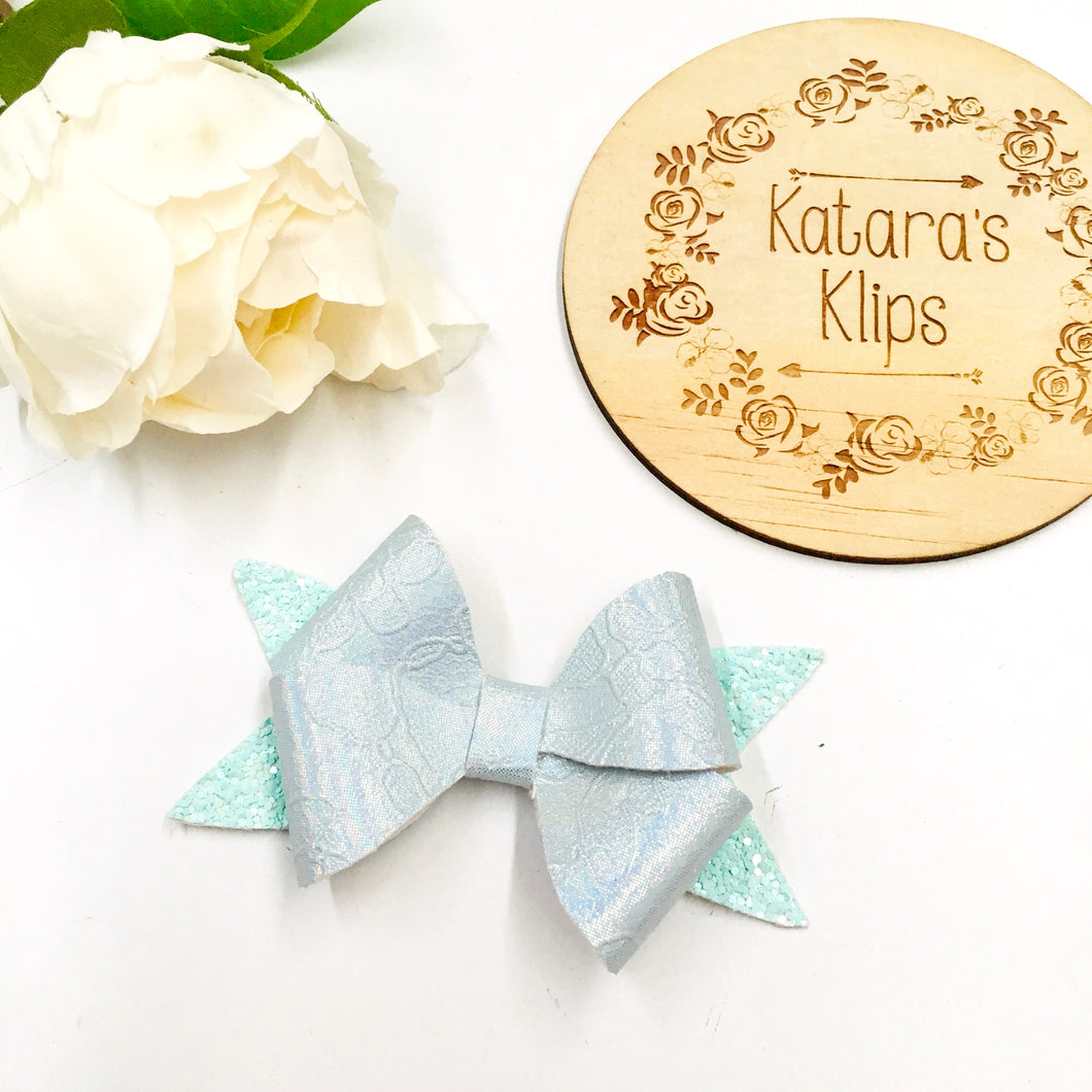 Pastel Blue Embossed Rosey bow