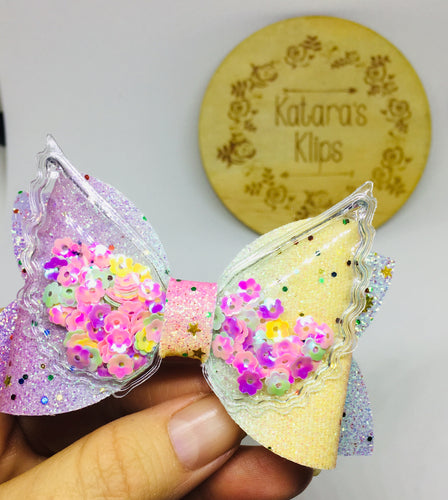 Sequin Wing Rainbow bow