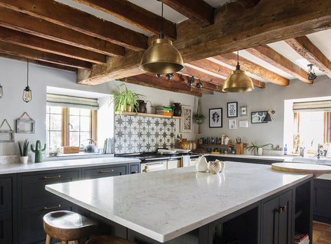 A rustic kitchen interior with industrial lighting by Industville