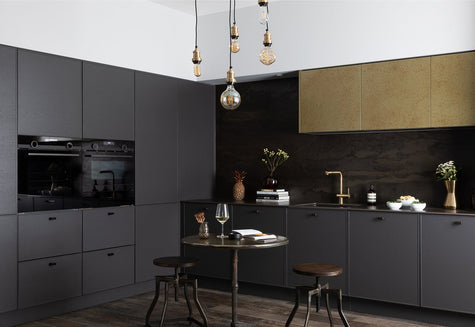 A dark modern interior with large bulb lighting by Industville