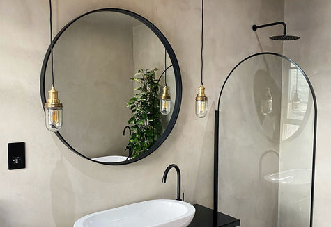 A modern minimalist bathroom interior with hanging lights by Industville